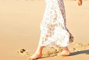 Grounding barefoot on beach
